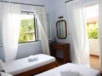 backside twin beds bedroom