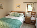 King size double room with solid oak furniture. Ensuite bathroom with excellent shower. Hair dryer.