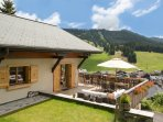 Summer terrace views onto the piste at Chalet 345