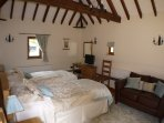 Twin bedded room with vaulted ceiling solid oak furniture. Shower room ensuite. Tv/dvd, hair dryer