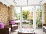 The relaxing conservatory space, looking out to the garden