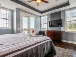 Master bedroom withSeale Posturpedic King Pillowtop mattress. TV is 55' High definition television.