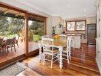 Dining/kitchen area overlooking rear deck & garden