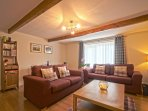 "The Living Room is spacious with character, 32"" LDC TV, Wii games console, books and DVDs"