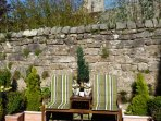 The outside space is landscaped and provides a lovely spot to sit and enjoy the sunshine.