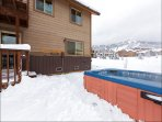 Large Hot Tub just steps from the home. with ski slope views