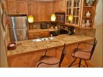 Granite, Stainless Steel, & Slate appoint the fully equipped Kitchen.