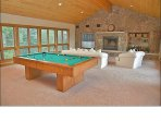 Game Room with Pool / Ping-Pong table, Wood Fireplace, Big Screen TV, & Bar.