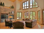 Living Room with 25 Foot Ceilings, 2 Story Windows, Large Fireplace & TV, Leather Furniture