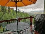 Outdoor dining & gas grill wight great views even on rainy days