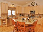 Kitchen with Beautiful  Granite Slab Counters, Stainless Steel Appliances