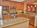 Modern Kitchen with Granite Counters, Stainless Steel Appliances, Custom Cabinets & Backsplash.