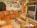 Lower Living Room with Leather Couch & Entertainment Center.