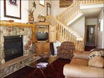 Living Room - Leather Couches, Vaulted Ceilings, Fireplace, LCD TV, & DVD.