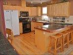 Kitchen, Bar, & Desk Nook with Hardwood & Granite
