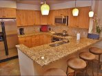 Beautiful Kitchen & Bar with Granite, Slate, & Stainless Steel.