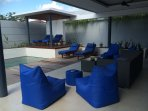 Nice relaxing social area overlooking the pool, indoor/outdoor entertainment area.