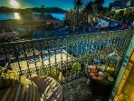 Watch the sun come up in the morning over Cap Ferrat from the balcony