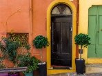 Front door to French townhouse leading to Casa Carlotta on the second floor