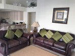 Family room with new sofas & TV, view over pool backs on to breakfast bar area and open plan kitchen
