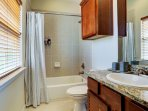 Guest bathroom with complimentary shampoo, conditioner and body wash