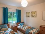 Twin bedroom: two single beds. Ensuite shower & WC