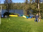 Lawn right up to lake with volley ball net and yard games and toys for all ages