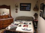 Fishing room has comfortable queen bed and full size futon. Fishing theme decor