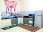 Spacious kitchen facilitate with fridge, microwave, induction cooker, jug kettle, rice cooker
