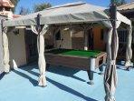 pool table near swimming pool area