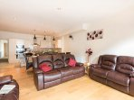 The large open plan lounge/kitchen/diner, separate cinema room with games console