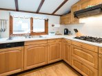 Well equipped kitchen with in built appliances