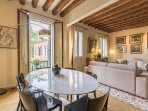 Veronese apartment dining/living room with access to the terrace
