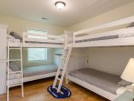 Kid's bedroom with four twin bunk beds.