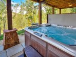 Spacious Hot Tub with custom lighting and stone patio
