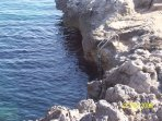 Steps in to the swimming cove. You can also enter from a beautiful cave