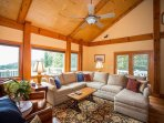Living room with beautiful vaulted ceilings and ample seating.