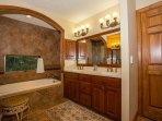 Master bath with large soaker tub and double vanity.