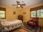 Upper level second guest room with queen bed.