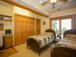Lower level bedroom with two twin beds.