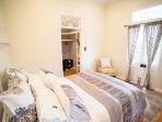 Second bedroom, doors open to front veranda, relax & watch the sunset. Walk through bathroom & robe