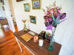 Hallway desk with scented candles and a guest signing book for you to comment on your stay