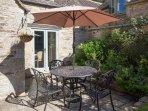 Sun-trap patio garden