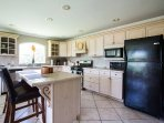 Large open Kitchen with plenty of room to entertain and cook your favorite dishes.
