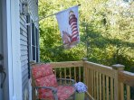 Front porch with comfortable chair.