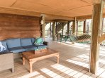Area under house (easy access from beach) with full bathroom, seating & dining areas & refrigerator