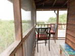 Wrap around porch with multiple nooks to sit and enjoy a cup of coffee. Front deck & side sundeck
