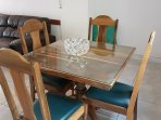 Wooden and glass dining table. Seats 4  people.