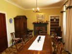 The dining room is handily placed close to the kitchen