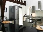 Modern kitchen with breakfast bar, so you can socialise with your group whilst cooking up a feast
